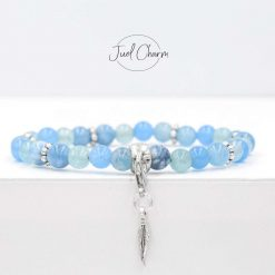 Handmade mixed Aquamarine gemstone bracelet shown with a feather charm
