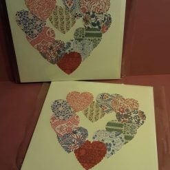 Heart themed card with vintage floral design.