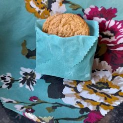 Eco friendly reuseable beeswax food wraps.  Set of Two. 20cms and 30cms.  Brilliant flowers and green.