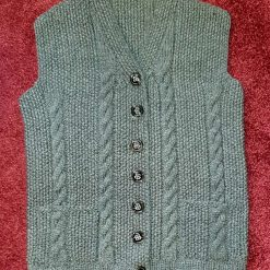Hand knitted buttoned waistcoat with pockets