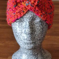 Crocheted patterned ear warmer...orange multi
