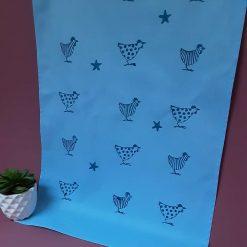 Handprinted blue cotton tea towel with chicken design.