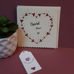Hand painted card with red heart design.