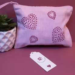 Hand printed pink cotton make-up bag with heart design