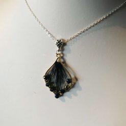 Black lyre shaped pendant