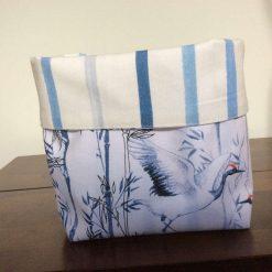 Reversible fabric basket in Laura Ashley Painterly Stripe Blue fabric and Crane Cotton Poplin.