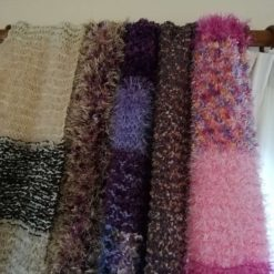 Multi coloured very warm and long adult scarves. 11