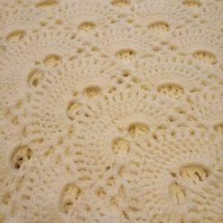Cream crocheted baby shawl