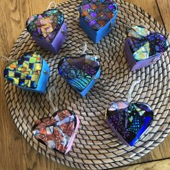 Fused dichroic glass heart on a rustic wooden box
