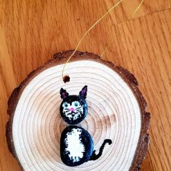 Black cat on wooden circle.  Pebble art ( I can add name)