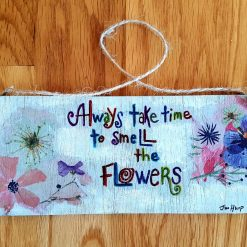 Always take time to smell the flowers. Wooden plaque.