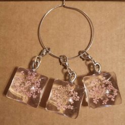 Square glass stitch markers for crochet or knitting.