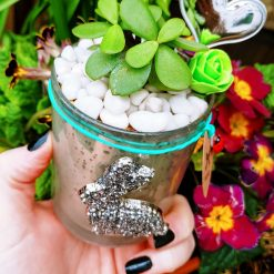 Gorgeous succulent in perlite & gritty cactus soil in plastic pot, placed in beautiful blue distressed glass pot with sparkly rabbit detail and Easter embellishments 🐤