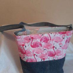 Pretty pink flamingo cotton and denim shoulder bag with a recessed zipper closure