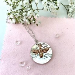 Silver disc necklace with rose gold bee