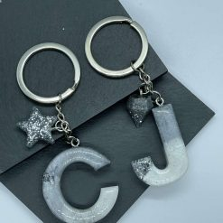 Grey, white and silver leaf initial keyring with charm
