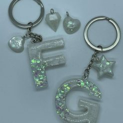 Handmade resin initial keyring. White and iridescent glitter with matching charm