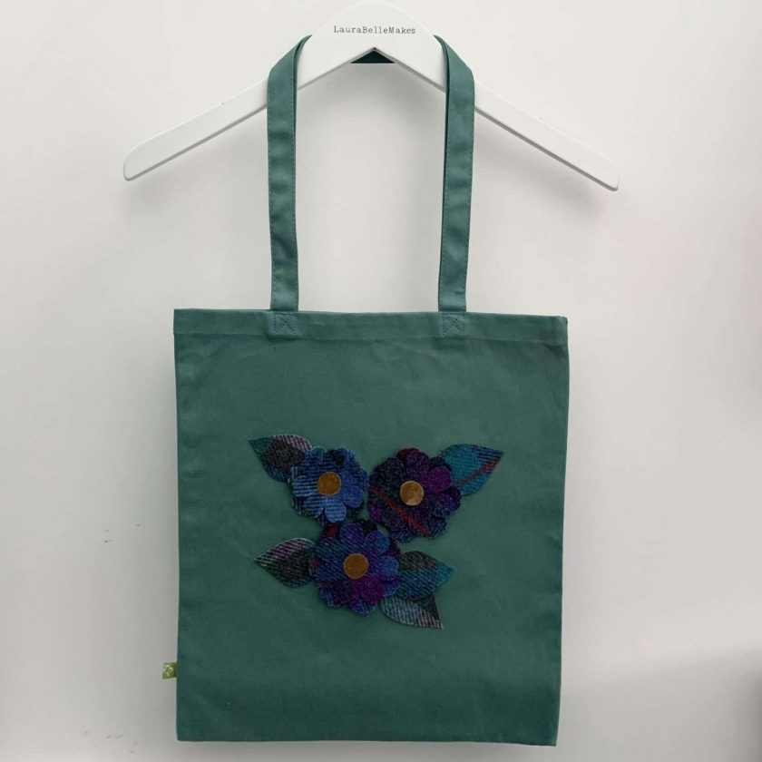 Organic cotton tote bag with floral Harris Tweed appliqué design and matching purse