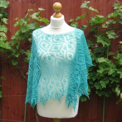 Handmade knitted lace crescent shape shawl with nupps, sea-green colour shawl