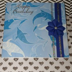"""Extra special folded paper rosette, greeting card with the words """"Happy birthday"""""""