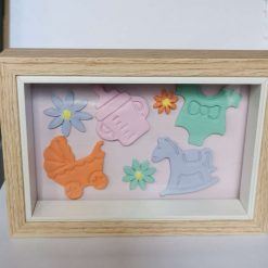 pastel coloured baby shapes framed picture