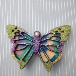 Flower, Wood and Clay fridge magnet.