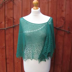 Handmade knitted wool lace crescent shawl with beads, bottle green colour
