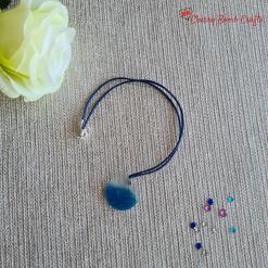 Glittery sea resin pendant necklace