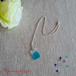 Blue sheer resin pendant necklace