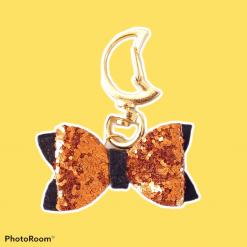 Bow bag charm, orange and white glitter