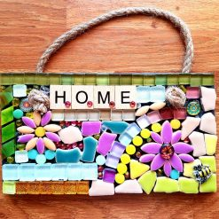 HOME mosaic on slate 18x10cms.  Can you find the little bumble bee?