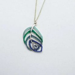 Peacock. Tibetan silver peacock pendant in greens and blues