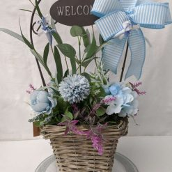 Welcome basket full of Blue artificial flowers