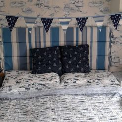 Blue boats and stripes bunting. Seaside, nautical, coastal theme
