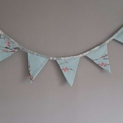 Bunting.  Pink blossom on blue