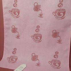 Pink cotton handprinted tea towel with tea pot design.