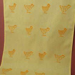 Handprinted yellow cotton tea towel with chicken design.