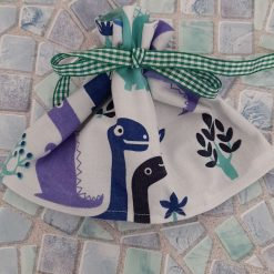 Gift bag/party bag. Eco-friendly reuseable.  Dinasour print.  Lined in green with a ribbon tie. Ready for you to fill with treats
