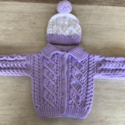 Babies hand knit Aran cardigan and hat set in lilac and white