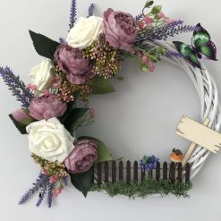 Purple wicker wreath with picket fence and robin