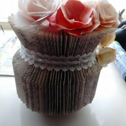 Hand-made bookfolding: a vase with flowers and lace trim