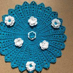 Blue crochet table centrepiece .