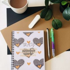 The Positive Daily Planner. A5, 180 pages. Undated. Original designs. 100% recyclable. With messages designed to boost mood & positivity.