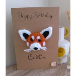 Knitted red panda birthday card