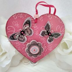 Decoupaged pink wooden heart hanging decoration with butterflies