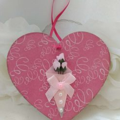 Decoupaged pink wooden heart hanging decoration with pink bouquet of flowers