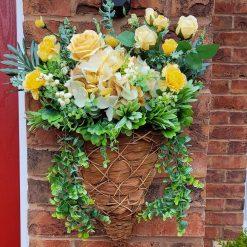Beautiful hand made sill flowered wall basket