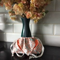 Origami inspired drawstring bag.
