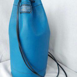 Blue holdall. Leather drawstring rucksack.  Backpack