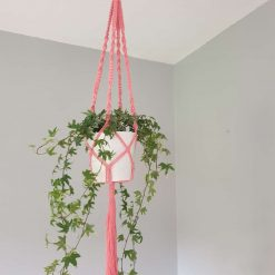 Handmade macrame plant hanger in salmon pink
